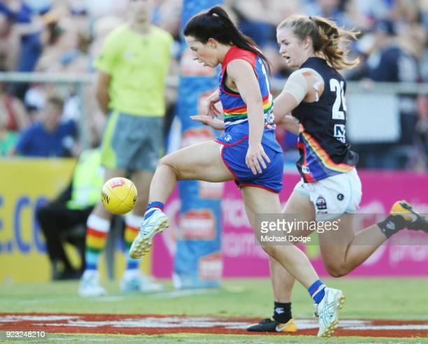 Brooke Lochland of the Bulldogs kicks the ball for a soccer style goal against Kate Shierlaw of the Blues during the round four AFLW match between...