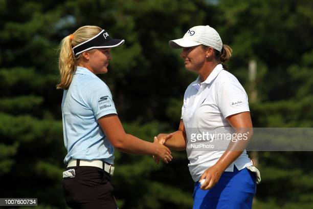 Brooke M Henderson and Angela Stanford shake hands after completing the 18th hole during the final round of the Marathon LPGA Classic golf tournament...