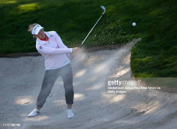 Brooke M Henderson hits out of a bunker for an eagle on the 14th hole during the final round of the Swinging Skirts LPGA Classic at the Lake Merced...