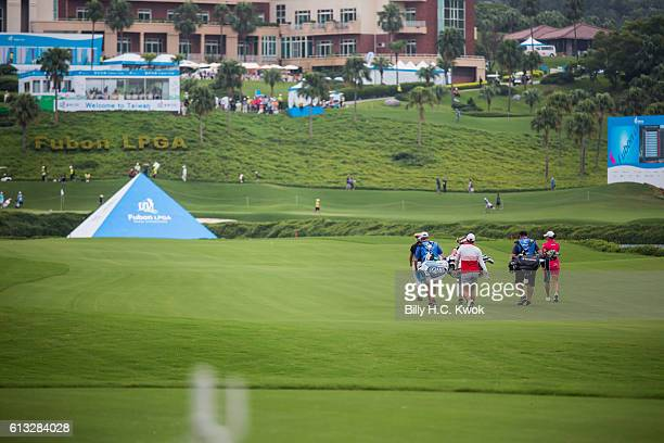 Brooke M Henderson Left Shanshan Feng Centre LeeAnne Pace right walks during the Fubon Taiwan LPGA Championship on October 8 2016 in Taipei Taiwan