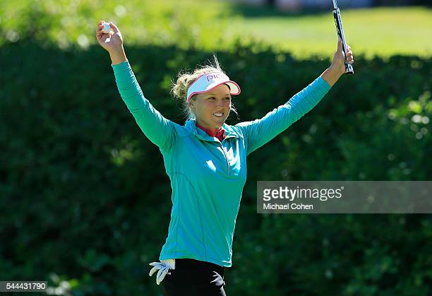 Brooke M Henderson of Canada celebrates on the 18th green after winning the Cambia Portland Classic held at Columbia Edgewater Country Club on July 3...