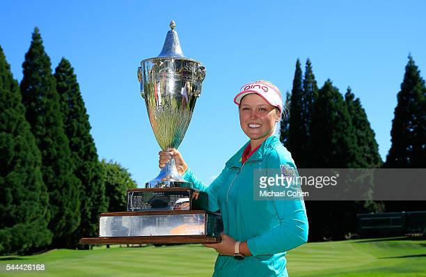 Brooke M Henderson of Canada holds the trophy after winning the Cambia Portland Classic held at Columbia Edgewater Country Club on July 3 2016 in...