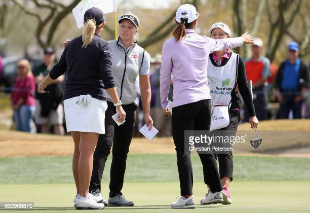 Brooke M Henderson of Canada hugs Cristie Kerr and Lydia Ko of New Zealand following the second round of the Bank Of Hope Founders Cup at Wildfire...