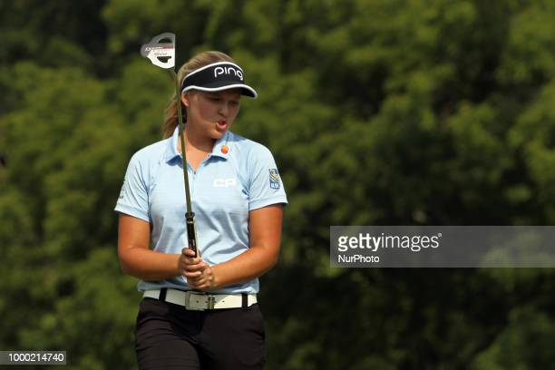 Brooke M Henderson of Smith Falls Ontario reacts after putting on the 18th green during the final round of the Marathon LPGA Classic golf tournament...