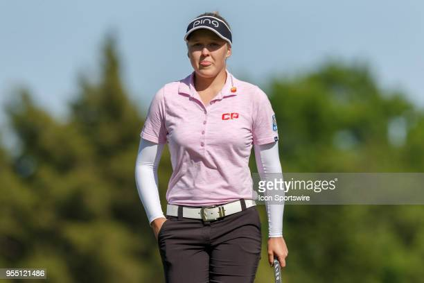 Brooke M Henderson walks off the third green during the LPGA Volunteers of America Texas Classic on May 5 2018 at the Old American Golf Club in The...