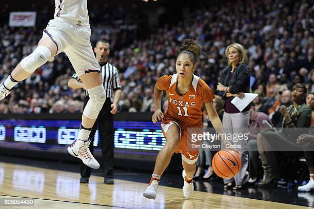 Brooke McCarty of the Texas Longhorns prepares to shoot while defended by Katie Lou Samuelson of the Connecticut Huskies during the UConn Huskies Vs...