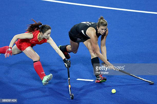 Brooke Neal of New Zealand and Yang Peng of China compete for the ball in the Women's Pool A match between the People's Republic of China and New...