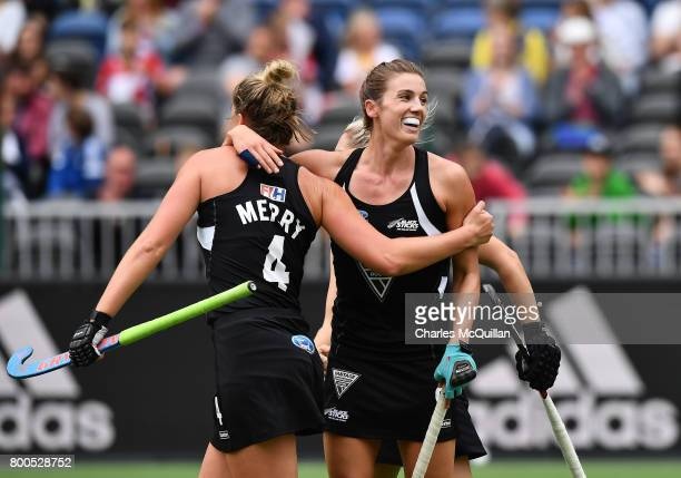 Brooke Neal of New Zealand is hugged by team mates after scoring from a penalty corner during the FINTRO Women's Hockey World League SemiFinal Pool B...