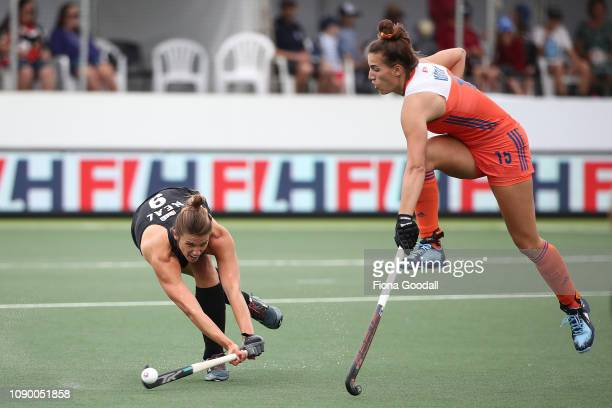 Brooke Neal of New Zealand takes a shot with Frederique Matla of the Netherlands during the Women's FIH Field Hockey Pro League match between New...