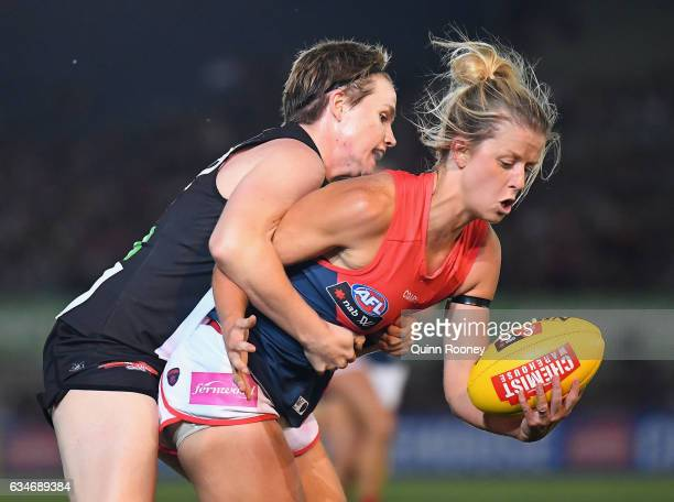 Brooke Patterson of the Demons is tackled by Jessica Cameron of the Magpies during the round two AFL Women's match between the Collingwood Magpies...