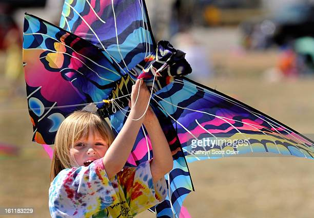 Brooke Payne from Arvada holds her kite above her head hoping for the next upcoming breeze The Arvada Festivals Commission and the Foothills Kite...