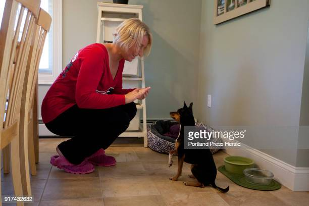 Brooke Quinn Dunphey asks her dog Piper to giver her paw for a treat at their home in Wells on Sunday October 1 2017 Dunphey and Piper arrived back...