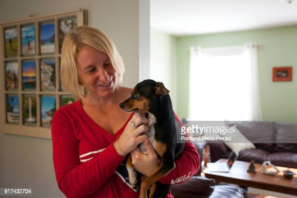 Brooke Quinn Dunphey holds her dog Piper at their home in Wells on Sunday October 1 2017 Dunphey and Piper arrived back in Maine late Saturday night...