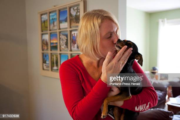 Brooke Quinn Dunphey kisses her dog Piper at their home in Wells on Sunday October 1 2017 Dunphey and Piper arrived back in Maine late Saturday night...