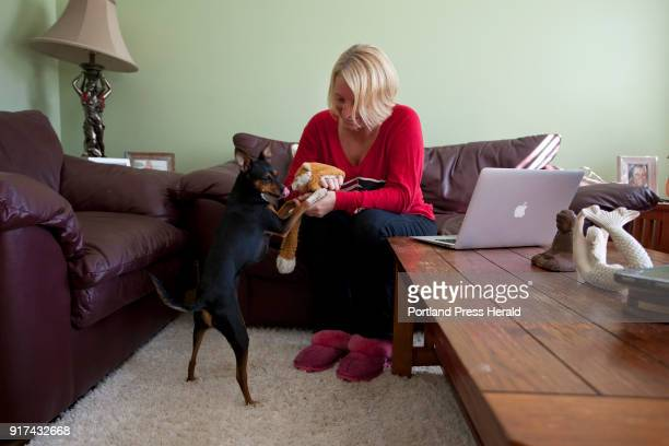 Brooke Quinn Dunphey plays with her dog Piper at their home in Wells on Sunday October 1 2017 Dunphey and Piper arrived back in Maine late Saturday...