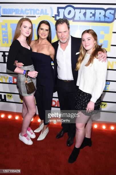 """Brooke Shields and Chris Henchy pose with guests at the screening of """"Impractical Jokers: The Movie"""" at AMC Lincoln Square Theater on February 18,..."""