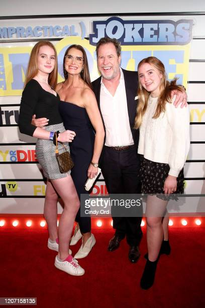 Brooke Shields and Chris Henchy pose with guests the Impractical Jokers The Movie New York Screening at AMC Lincoln Square Theater on February 18...