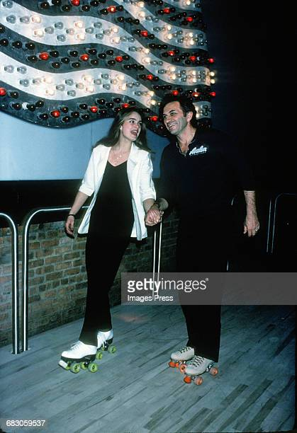Brooke Shields and concert promoter Bill Graham rollerskating at The Roxy circa 1979 in New York City
