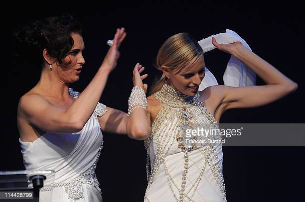 Brooke Shields and Karolina Kurkova onstage at amfAR's Cinema Against AIDS Gala during the 64th Annual Cannes Film Festival at Hotel Du Cap on May...