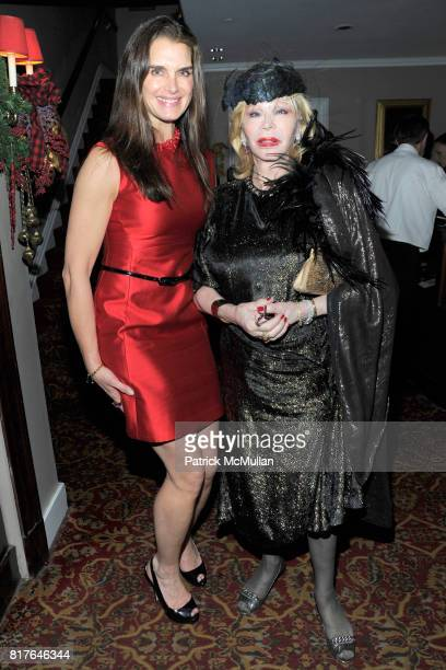 Brooke Shields and Monique van Vooren attend ANNE HEARST MCINERNEY JAY MCINERNEY and GEORGE FARIAS Holiday Party at 21 Club on December 16 2010 in...
