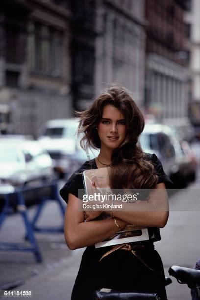 Brooke Shields Holding Magazines