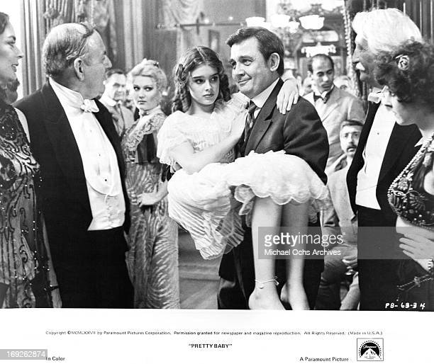 Brooke Shields is carried by the man who won the auction for her virginity in a scene from the film 'Pretty Baby' 1978