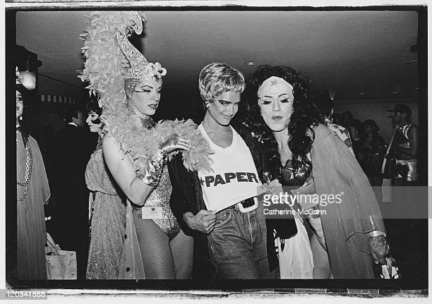 Brooke Shields Joey Arias and unidentified drag queen pose for a photo at the Love Ball in May 1991 in New York City New York