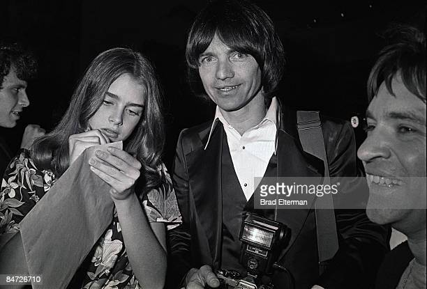 LOS ANGELES JANUARY 01 1980 Brooke Shields photographer Julian Wasser and Rodney Bingenheimer at a party for Blondie in Los Angeles California...