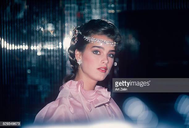 Brooke Shields wearing a pink ruffled dress and a jeweled headpiece circa 1970 New York