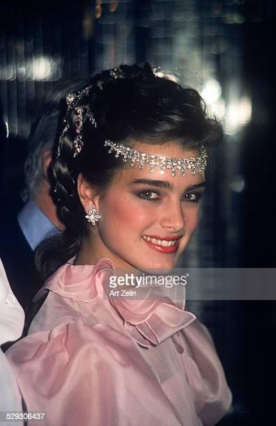 Brooke Shields wearing pink and a jeweled headpiece circa 1970 New York