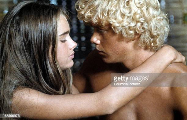 Brooke Shields with her arms around Christopher Atkins shoulders in a scene from the film 'Blue Lagoon', 1980.