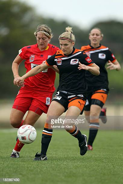 Brooke Spence of Brisbane competes with Marijana Rajcic of Adelaide during the round four WLeague match between Adelaide United and the Brisbane Roar...