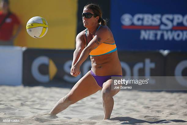 Brooke Sweat digs the ball against Heather Hughes and Whitney Pavlik at the AVP Championships at Huntington Beach on September 20 2014 in Huntington...