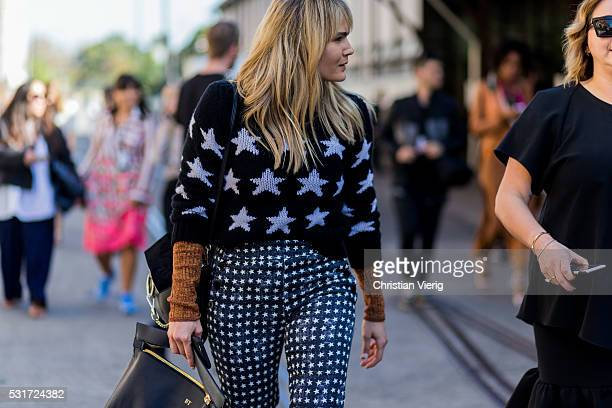 Brooke Testoni wearing a black sweater with star print and pants outside Georgia Alice at MercedesBenz Fashion Week Resort 17 Collections at...
