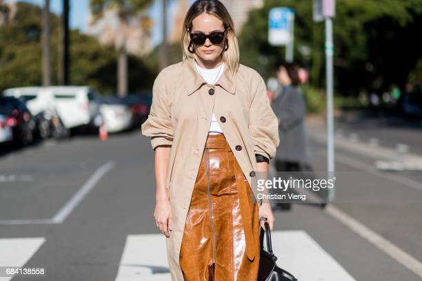 Brooke Testoni wearing a brown long skirt black bag trench coat Vans outside Ginger Smart at day 4 during MercedesBenz Fashion Week Resort 18...
