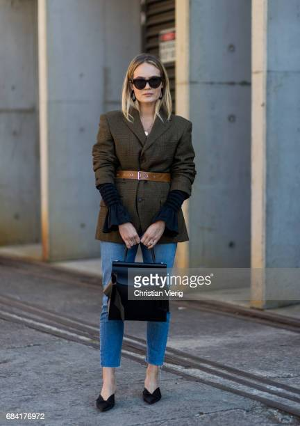 Brooke Testoni wearing an olive blazer with brown belt denim jeans at day 4 during MercedesBenz Fashion Week Resort 18 Collections at Carriageworks...