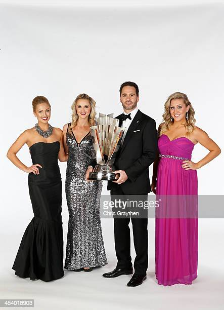 Brooke Werner Kim Coon and Jaclyn Roney pose with NASCAR Sprint Cup Series Champion Jimmie Johnson pose for a portrait prior to the NASCAR Sprint Cup...