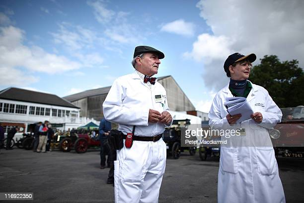 Brooklands Museum volunteers Brian Williams and Jacqui Stark watch the arrival of vehicles at The Brooklands Double Twelve Motorsport Festival on...
