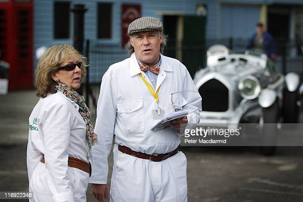 Brooklands Museum volunteers Diana Willows and Colin Ranshaw watch the arrival of vehicles at The Brooklands Double Twelve Motorsport Festival on...