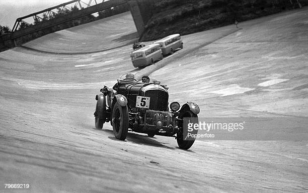 Brooklands Race Circuit Surrey England 8th May 1930 Hon Dorothy Paget's Bentley passes the timekeepers buses as she practices for the 'Double 12 Hour...