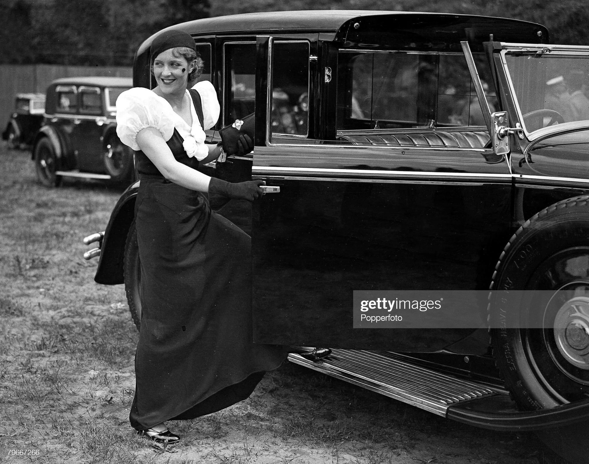Brooklands' Surrey, England, 2nd July, 1932, Film actress Betty Stockfield about to enter her 1900 Benz at the Brooklands Track Gala in aid of the Guy's Hospital : News Photo