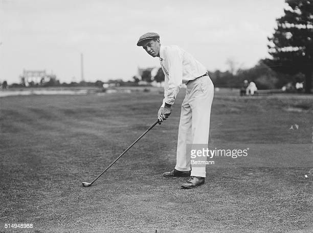 Brookline, MA.: Photo of American golfer, Francis Ouimet, , posing in a driving stance. Ouimet was the first winner of the U. S. Open.