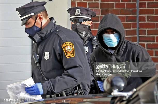 Brookline Police lead Zanini Cineus into Brookline Municipal Court after he was arrested for breaking into Tom Brady and Gisele Bündchen's Brookline...