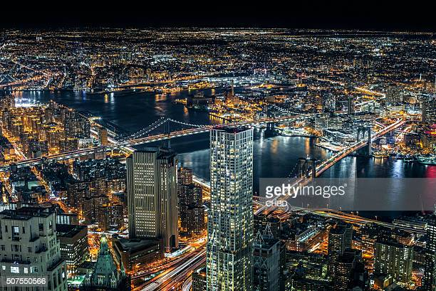 brooklyn and manhattan bridge aerial view at night - queens new york city stock pictures, royalty-free photos & images