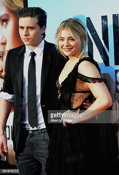 Brooklyn Beckham and actress Chloë Grace Moretz arrive for the Premiere Of Universal Pictures' 'Neighbors 2 Sorority Rising' held at Regency Village...