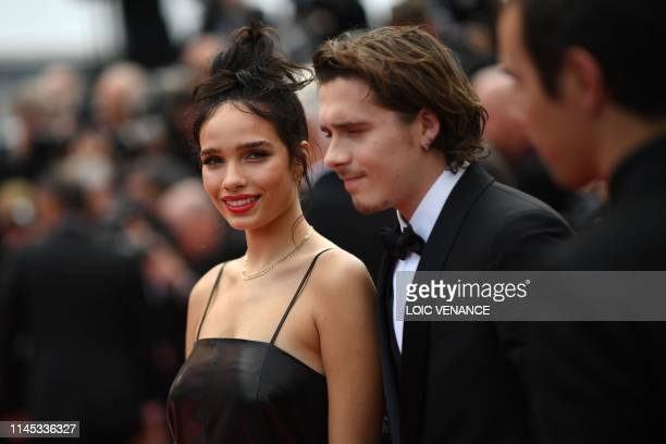 Brooklyn Beckham and British model Hana Cross arrive for the screening of the film Once Upon a Time in Hollywood at the 72nd edition of the Cannes...