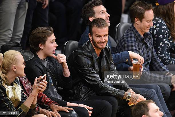Brooklyn Beckham and David Beckham attend a basketball game between the Utah Jazz and the Los Angeles Lakers at Staples Center on April 13 2016 in...
