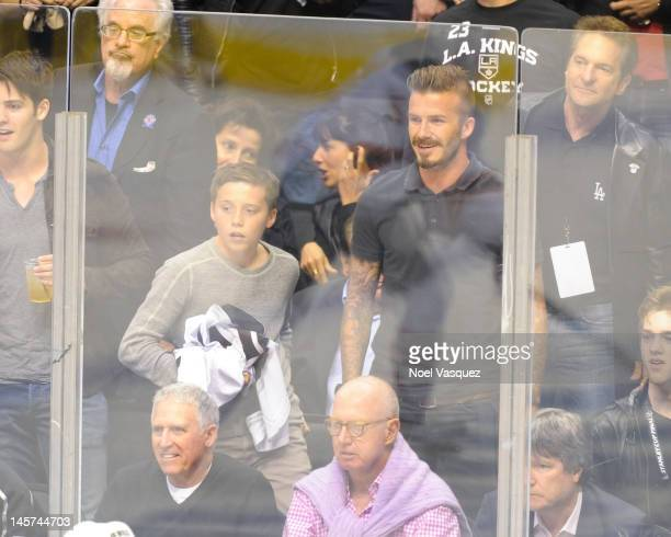 Brooklyn Beckham and David Beckham attend game three of the 2012 Stanley Cup Final between the Los Angeles Kings and the New Jersey Devils at Staples...