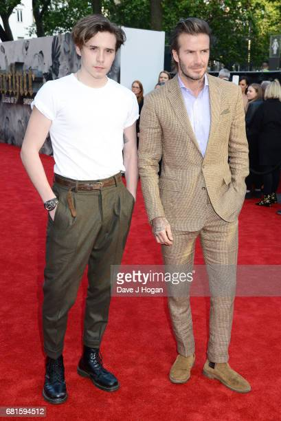 Brooklyn Beckham and David Beckham attend the European premiere of 'King Arthur Legend of the Sword' at Cineworld Empire on May 10 2017 in London...