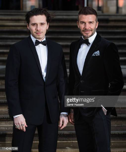 """Brooklyn Beckham and David Beckham attend the """"Our Planet"""" global premiere at Natural History Museum on April 04, 2019 in London, England."""